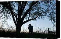 Cowboy Hat Canvas Prints - A Young Boy Is Silhouetted Canvas Print by Joel Sartore