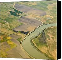 Cultivation Canvas Prints - Aerial View of a River Passing Through Farmland Canvas Print by Eddy Joaquim
