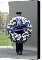 Commemorating Canvas Prints - Airman Holds A Wreath During A Ceremony Canvas Print by Stocktrek Images