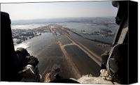 Natural Disasters Canvas Prints - Airmen Fly Over The Sendai Airport Canvas Print by Stocktrek Images