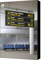 Airport Terminal Canvas Prints - Airport Directional Signs Canvas Print by Jaak Nilson