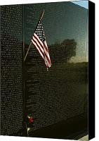 War Monuments And Shrines Canvas Prints - American Flag Left At The Vietnam Canvas Print by Medford Taylor