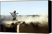 Insurgency Canvas Prints - An Afghan National Army Soldier Fires Canvas Print by Everett