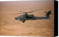 Operation Iraqi Freedom Canvas Prints - An Ah-64d Apache Longbow Fires A Hydra Canvas Print by Terry Moore
