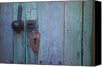 Turquoise And Rust Canvas Prints - An antique lock on a Canvas Print by Raul Touzon