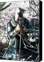 Rangefinder Canvas Prints - An Army Ranger Sets Up An Anpaq-1 Laser Canvas Print by Stocktrek Images