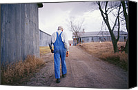 Dirt Roads Photo Canvas Prints - An Elderly Farmer In Overalls Walks Canvas Print by Joel Sartore