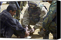 Second Gulf War Canvas Prints - An Iraqi Detainee Receives A Band-aid Canvas Print by Everett