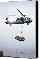 Warship Canvas Prints - An Mh-60s Knighthawk Delivering Cargo Canvas Print by Stocktrek Images
