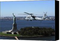Warship Canvas Prints - An Mh-60s Knighthawk Flies Canvas Print by Stocktrek Images