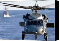 Warship Canvas Prints - An Mh-60s Seahawk Helps Conduct Canvas Print by Stocktrek Images