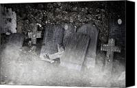 Eerie Canvas Prints - An Old Cemetery With Grave Stones And Fog Canvas Print by Joana Kruse