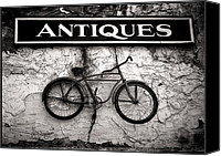 Building Canvas Prints - Antiques and The Old Bike Canvas Print by Bob Orsillo