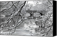 Frozen Canvas Prints - Arch Bridge Over Frozen River In Winter Canvas Print by Enzo Figueres