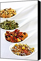 Mint Canvas Prints - Assorted herbal wellness dry tea in spoons Canvas Print by Elena Elisseeva