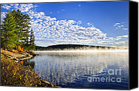 Tranquil Canvas Prints - Autumn lake shore with fog Canvas Print by Elena Elisseeva