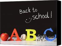 Reading Canvas Prints - Back to school concept with abc letters Canvas Print by Sandra Cunningham