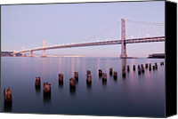 Wooden Post Canvas Prints - Bay Bridge And Pilings Canvas Print by Photograph by Daniel Pivnick