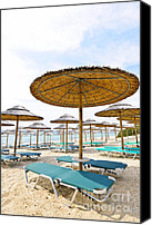 Umbrellas Canvas Prints - Beach umbrellas and chairs on sandy seashore Canvas Print by Elena Elisseeva