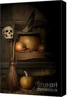 Skull Canvas Prints - Big pumpkin with black witch hat and broom Canvas Print by Sandra Cunningham