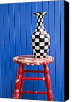 Stool Canvas Prints - Blach and white vase on stool against blue wall Canvas Print by Garry Gay