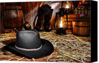 Oil Lamp Canvas Prints - Black Cowboy Hat in an Old Barn Canvas Print by Olivier Le Queinec
