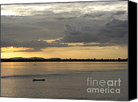 Nawarat Namphon Canvas Prints - Boat on river at sunset Canvas Print by Nawarat Namphon