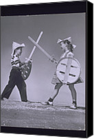 10:7 Canvas Prints - Boy And Girl (7-10) Crossing Toy Swords (b&w) Canvas Print by Archive Holdings Inc.