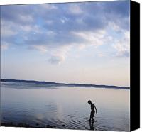 Cienfuegos Canvas Prints - Boy In Silhouette Wading In Ocean Canvas Print by Axiom Photographic
