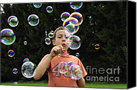 Soap Bubbles Canvas Prints - Boy with colorful bubbles Canvas Print by Matthias Hauser