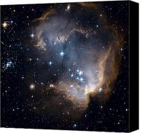 Hubble Canvas Prints - Bright Blue Newborn Stars Blast A Hole Canvas Print by ESA and nASA