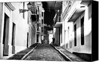 Architecture Photo Canvas Prints - Calle Oscura Canvas Print by John Rizzuto