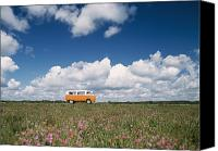 Campervan Canvas Prints - Campervan Going Down Road In Front Of Canvas Print by Axiom Photographic