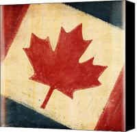 Patriotism Photo Canvas Prints - Canada flag Canvas Print by Setsiri Silapasuwanchai
