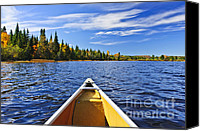Tranquil Canvas Prints - Canoe bow on lake Canvas Print by Elena Elisseeva