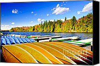 Docks Photo Canvas Prints - Canoes on autumn lake Canvas Print by Elena Elisseeva