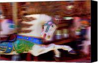 Merry-go-round Canvas Prints - Carousel horse in motion Canvas Print by Garry Gay