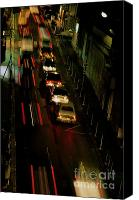 Raining Canvas Prints - Cars travelling along a street during a rainy night Canvas Print by Sami Sarkis