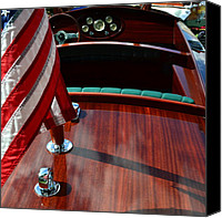 Wooden Boat Canvas Prints - Chris Craft with Flag and Steering Wheel Canvas Print by Michelle Calkins