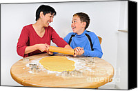 Son Canvas Prints - Christmas baking - mother and son laughing Canvas Print by Matthias Hauser