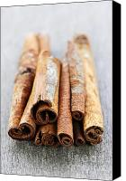 Spice Canvas Prints - Cinnamon sticks Canvas Print by Elena Elisseeva