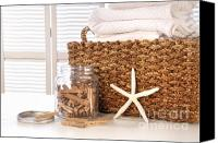 White Starfish Canvas Prints - Closeup of laundry basket with fine linens  Canvas Print by Sandra Cunningham