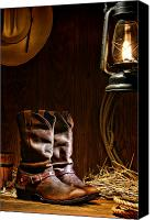 Straw Canvas Prints - Cowboy Boots at the Ranch Canvas Print by Olivier Le Queinec