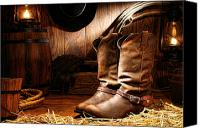 Cowboy Photo Canvas Prints - Cowboy Boots in a Ranch Barn Canvas Print by Olivier Le Queinec