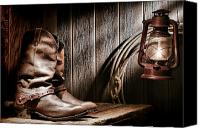 Oil Lamp Canvas Prints - Cowboy Boots in Old Barn Canvas Print by Olivier Le Queinec