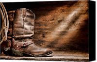 Riding Canvas Prints - Cowboy Boots on Wood Floor Canvas Print by Olivier Le Queinec