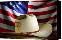 Waving Canvas Prints - Cowboy Hat and American Flag Canvas Print by Olivier Le Queinec