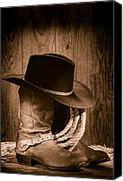 Straw Canvas Prints - Cowboy Hat and Boots Canvas Print by Olivier Le Queinec