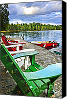 Rowboats Canvas Prints - Deck chairs on dock at lake Canvas Print by Elena Elisseeva
