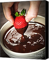 Fingers Photo Canvas Prints - Dipping strawberry in chocolate Canvas Print by Elena Elisseeva
